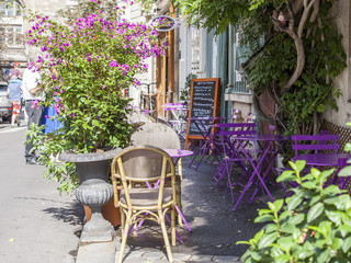 Fototapeta Paryż PARIS, FRANCE, on AUGUST 29, 2015. Picturesque summer cafe on the street.