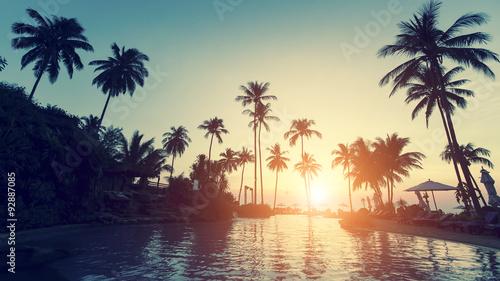 Foto op Aluminium Bomen Asian tropical beach during an surrealistic sunset.