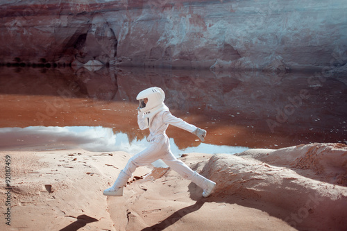 Fotografia  futuristic astronaut on another planet, image with the effect of