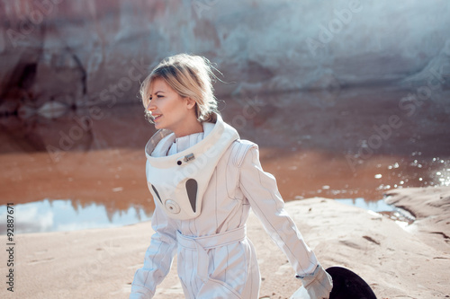 Water on Mars, futuristic astronaut without a helmet in another Poster