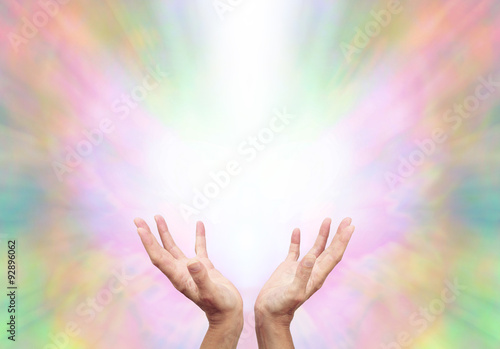 Photo  Angelic Energy Healer - Female energy worker with hands outstretched and open up