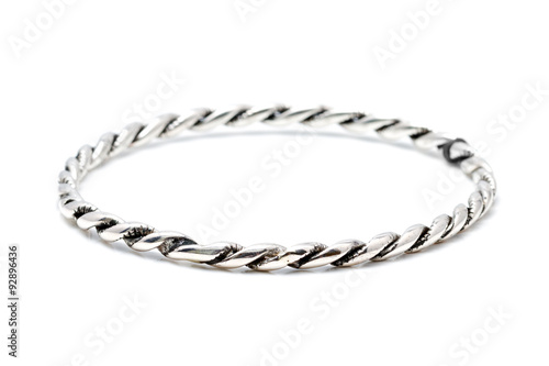 Fotografía  Silver slave bangle bracelet against a white background