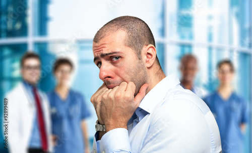 Photo  Scared guy in front of an hospital