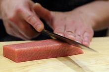 Hand Of Japanses Sushi Chef Slice A Sashimi
