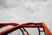 The Steel Construction Of Red Bridge On A Monochromatic Background