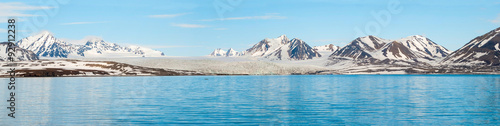 Panorama of glacier above the sea with mountains behind, Svalbar