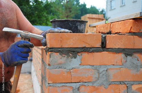 Bricklayer Using A Bricklaying Hammer To Build New Red Brick Wall Outdoor Basics Masonry