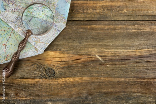 Spoed Foto op Canvas Wereldkaart Eastern Europe Modern Road Map And Magnifier On The Wood Table