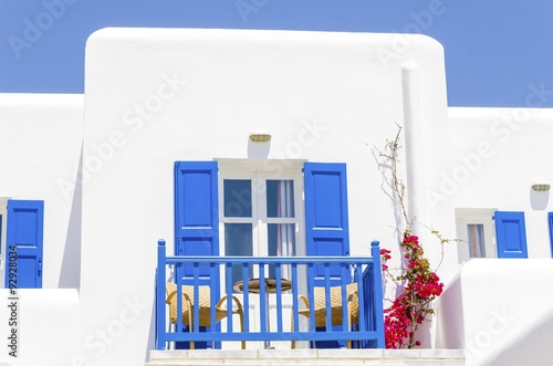 A Trational Whitewashed Cubic Beach Greek Island Holiday Apartment With Blue Wooden Windows And Blacony