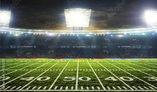 Obraz na plátně Soccer ball on the field of stadium