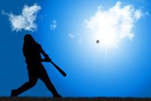 태양을 향해 공을 치는 야구의 타자