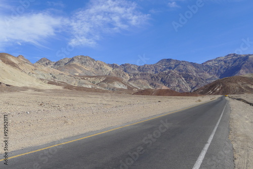 Photo Stands Eggplant Mountain, Desert and Road in Death Valley National Park