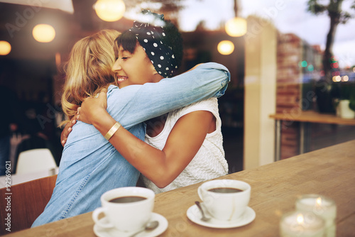 Photo  Two affectionate girl friends embracing