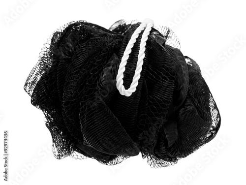 Fotografie, Obraz  Exfoliating black mesh sponge on a white background