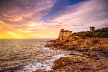 Boccale castle landmark on cliff rock and sea on warm sunset. Tu