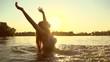 Beauty summer model girl splashing water in the river
