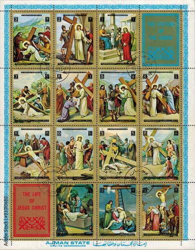 Fotografia Ajman - CIRCA 1972: mail stamp printed in Ajman the court, carrying the cross, c