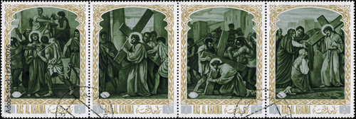 Fototapeta Ras al Khaimah - CIRCA 1972: mail stamp printed in Ras al Khaimah the court, carrying the cross, crucifixion, descent from the cross and burial of Jesus Christ