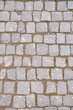Old grey pavement in a pattern in an old medieval european town.