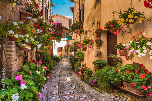 Canvas Print Floral street in central Italy, in the small Umbrian medieval to