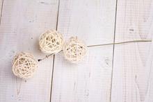 White Wicker Balls  On White Rustic Wooden Background. Home Decoration