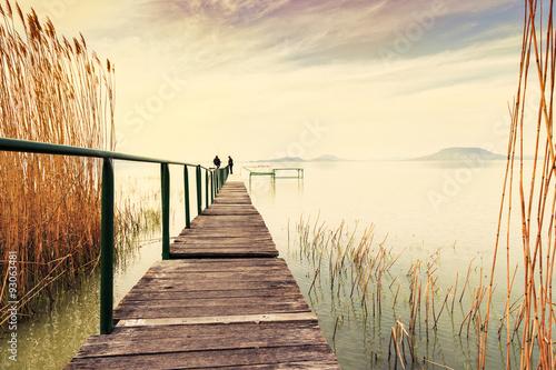 Photo  Wooden pier in tranquil lake Balaton