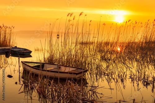Deurstickers Zwavel geel Sunset on the lake Balaton with a boat