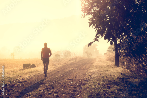Fotografie, Obraz  Man running on a path in a forest
