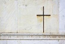 Iron Cross Snuggled In White Stone On A Italian Facade Church