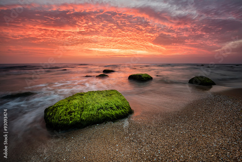 Canvas Prints Cappuccino Sea sunrise. Amazing sea sunrise with slow shutter and waves flowing out.