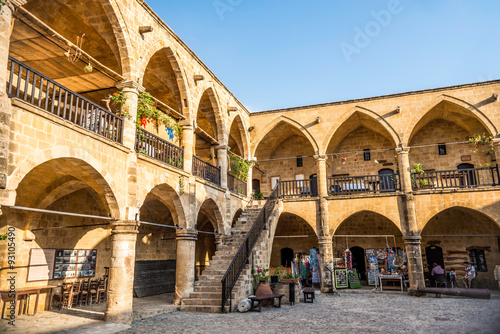 Foto op Aluminium Cyprus NICOSIA, CYPRUS - AUGUST 10, 2015: Buyuk Han (The Great Inn) a touristic center with an antique souvenir shops, craft workshops and cafes in Nicosia, Cyprus on August 10,2015