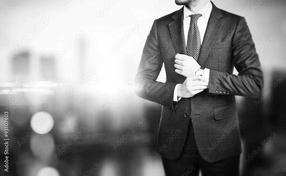 Fototapeta BW picture of young business man on a blured background