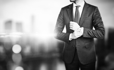 BW picture of young business man on a blured background