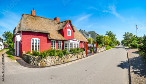Spoed Foto op Canvas Scandinavië Beautiful and traditional thatched house in german north sea village