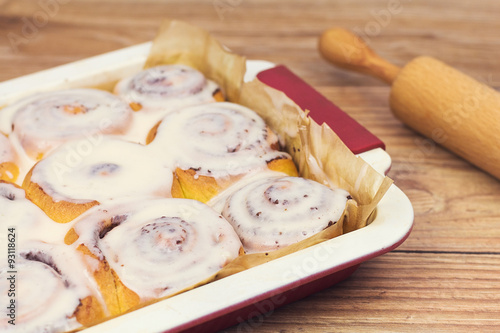 Fotografie, Obraz  Delicious cinnamon rolls with rolling pin