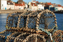 Lobster Pots Stacked On The Harbor
