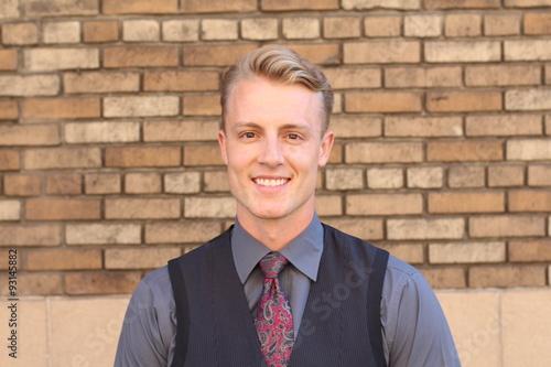 Fotografie, Obraz  Portrait of a blonde young man outside