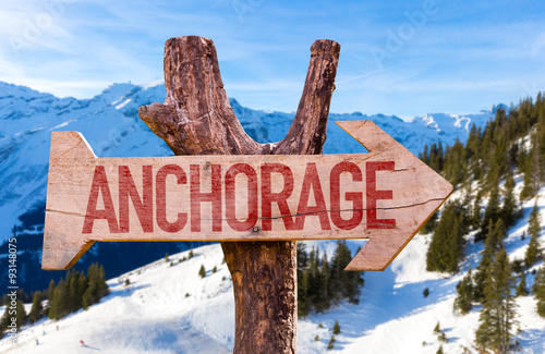 Photo Anchorage wooden sign with winter background