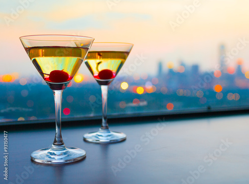 Fotografie, Obraz  Cocktail glasses with city view.