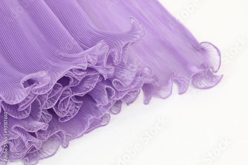 Fotografie, Obraz  Pressing on a purple chiffon white background.
