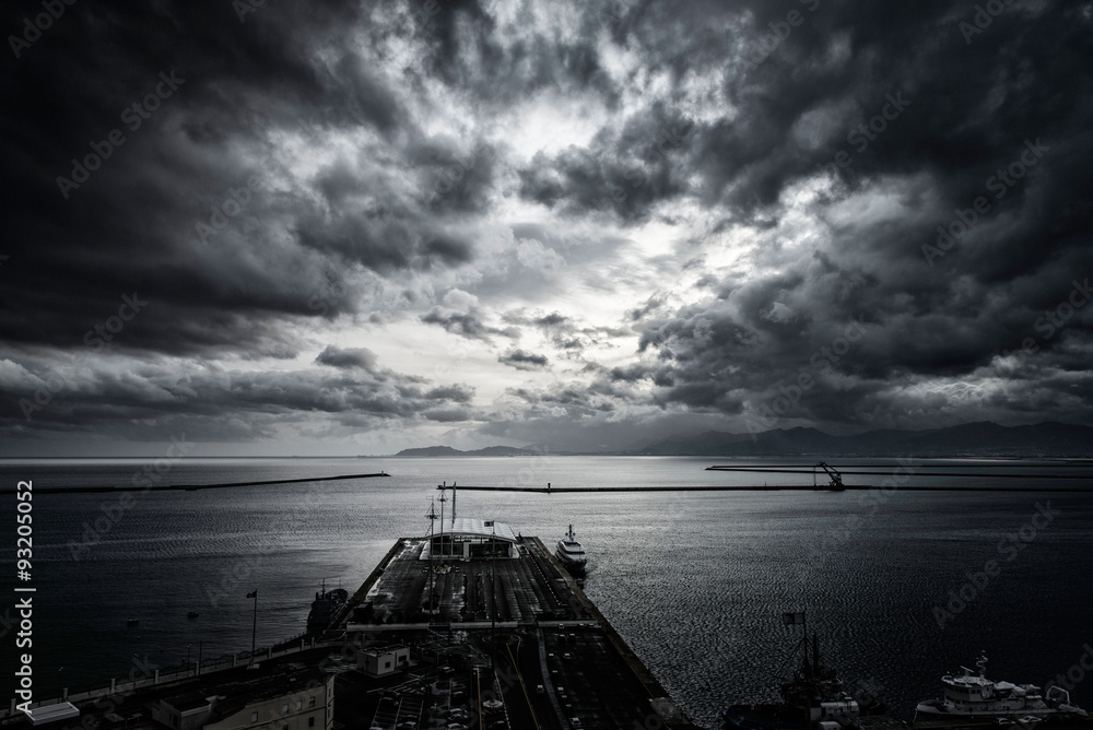 Fototapeta dramatic sky above the harbor