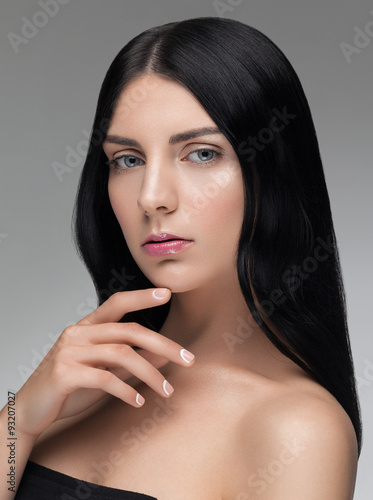 plakat Beautiful portrait closeup of a young woman with black hair and nude makeup.