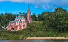 Old Russian Orthodox Church And Bell Tower Along The Volga River Painted Pink And White With Blue Roof And Domes