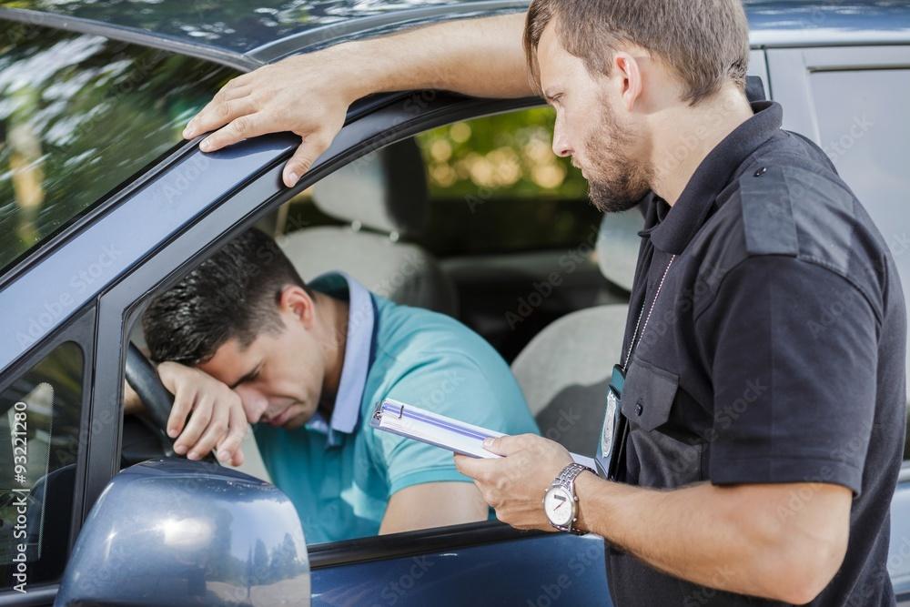 Fototapety, obrazy: Sad man in car