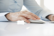 Close-up Of Woman's Hand Using Computer Mouse