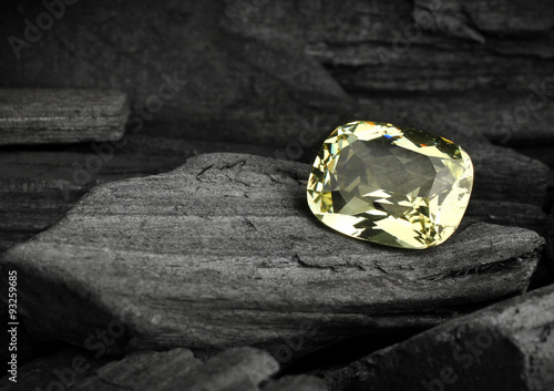 faceted yellow jewelry gemstone on darck background