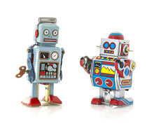 Two Retro Tin Robot On A White...