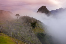Machu Picchu, Cusco, Peru In The Early Morning Mist, Found On The Steep Slopes Of The Andes Mountains.