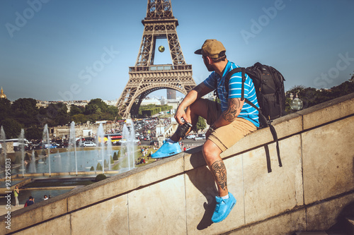 Tourist man in summer clothing over elfel tower.