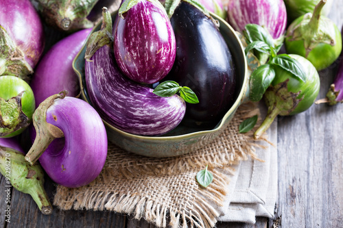 Photo  Eggplants of different variety on the table